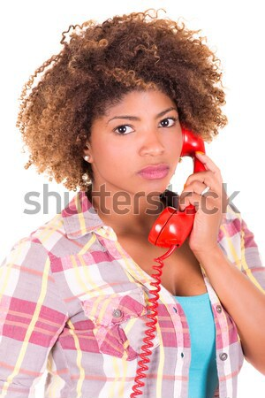 Afro-American young woman answering a call, isolated on white background Stock photo © pxhidalgo