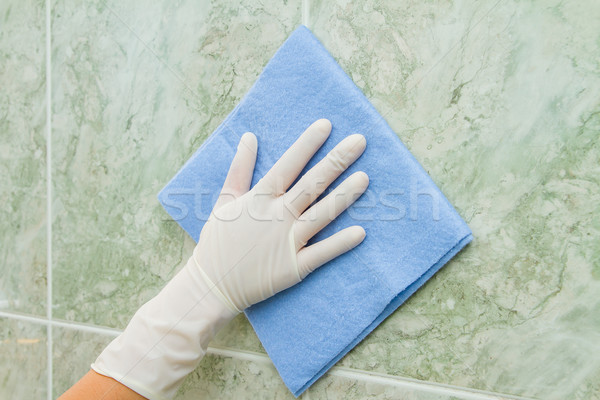 female hand cleaning kitchen tiles with sponge Stock photo © pxhidalgo
