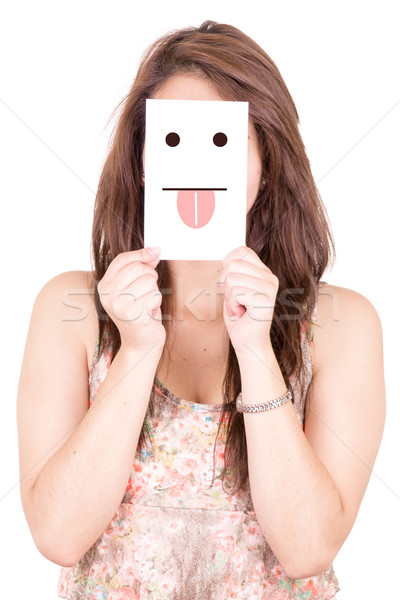 Young woman holding a paper with a cute smiley face with tongue out Stock photo © pxhidalgo