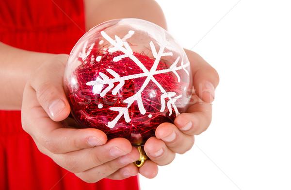 Child Hand holding a christmass ornament Stock photo © pxhidalgo