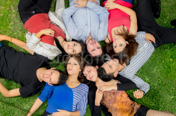 Group of friends laying down in park Stock photo © pxhidalgo