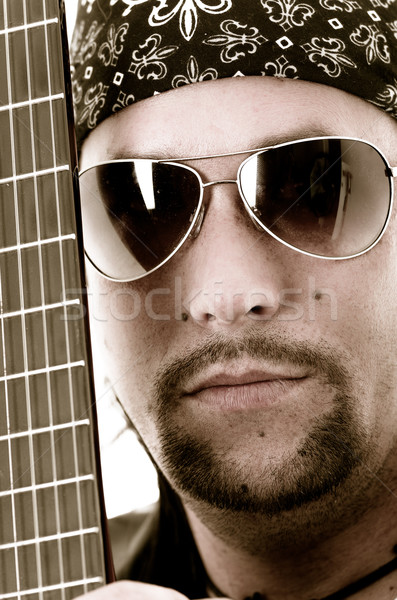 musician and his guitar Face and strings Stock photo © pxhidalgo
