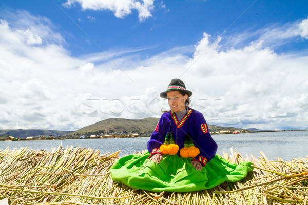 Young girl on a floating Uros island, Titicaca Stock photo © pxhidalgo