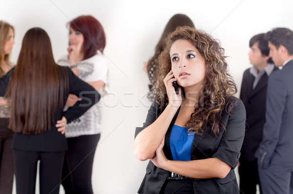 Hispanic woman using a cellphone with peers Stock photo © pxhidalgo