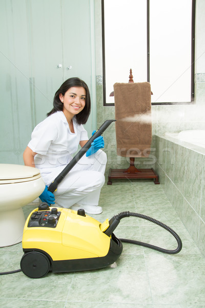 cleaning lady  with steam machine, logos removed Stock photo © pxhidalgo
