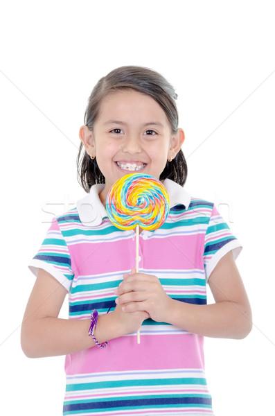 Cute hispanic little girl holding big lolly pop on white background Stock photo © pxhidalgo