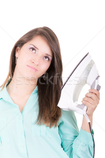 Happy young beautiful woman ironing clothes. Housework Stock photo © pxhidalgo