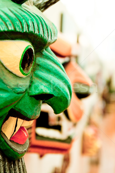 Colorfully painted wooden South American mask Stock photo © pxhidalgo