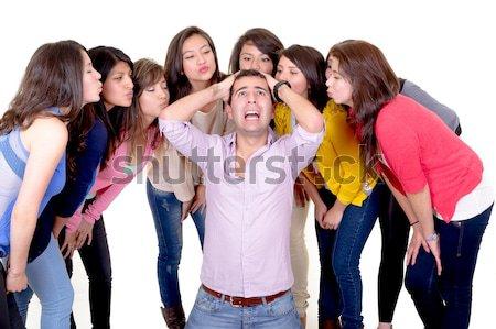 Acht jonge vrouwen zoenen knappe man permanente geïsoleerd Stockfoto © pxhidalgo