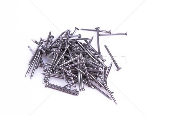 pile of iron Nails isolated on white background. Stock photo © pxhidalgo