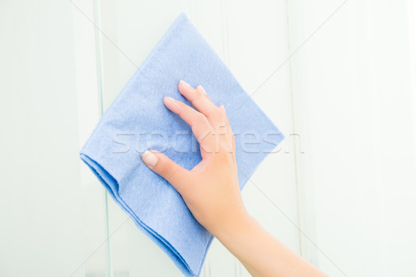 Hand with blue sponge cleaning the bathroom glass Stock photo © pxhidalgo