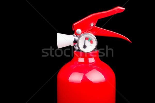 Red fire extinguisher isolated on a black background Stock photo © pxhidalgo