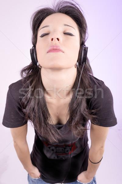 Relaxed woman listening to music studio shot Stock photo © pxhidalgo