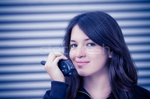Businesswoman in warehouse using walkie-talkie Stock photo © pxhidalgo