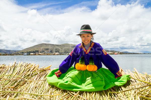 Sitting girl on a floating Uros island, Titicaca Stock photo © pxhidalgo