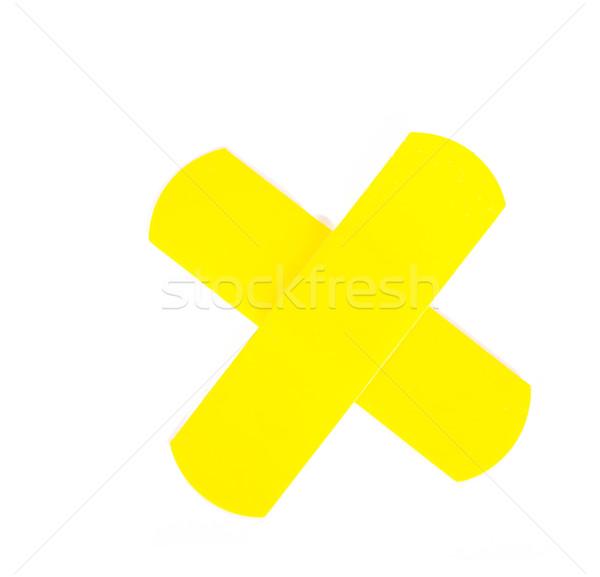 Stock photo: yellow adhesive bandage in x shape