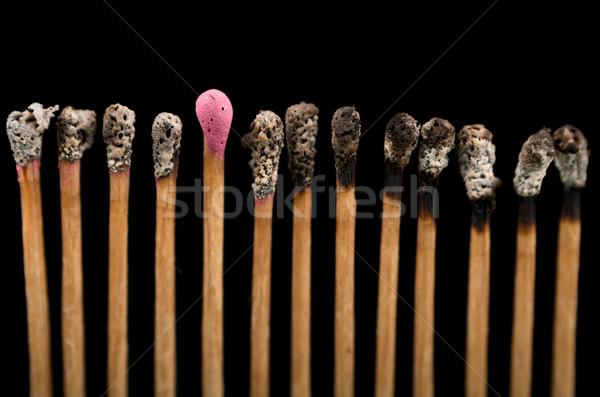 Burned Matchsticks isolated on black background Stock photo © pxhidalgo