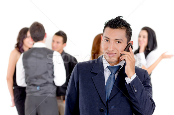 Businessman using a cellphone with peers Stock photo © pxhidalgo
