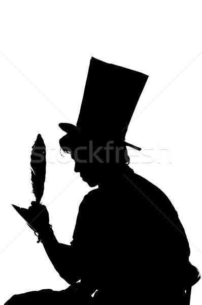Silhouette uomo seduta sgabello iscritto notebook Foto d'archivio © pxhidalgo