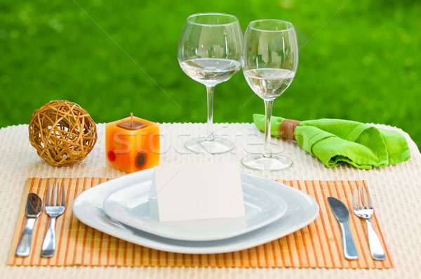 Empty classic white plate in a restaurant with blank card and copyspace for example guest names. Stock photo © pxhidalgo