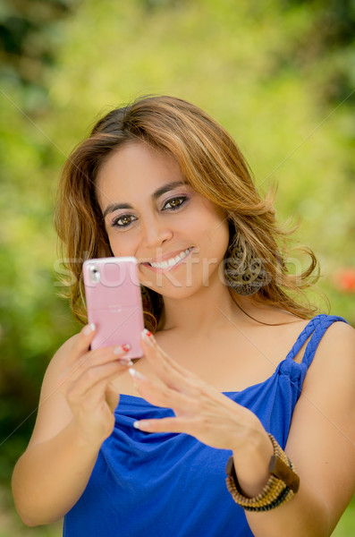 Woman messaging on her smart phone Stock photo © pxhidalgo