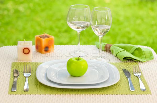 Alma tányér villa kés legelő asztal Stock fotó © pxhidalgo