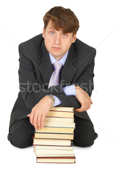 Young erudition man with stack of books Stock photo © pzaxe