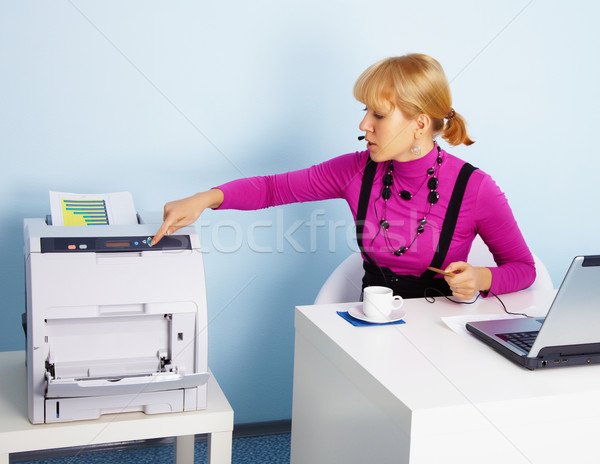 Young woman - secretary prints out a document Stock photo © pzaxe