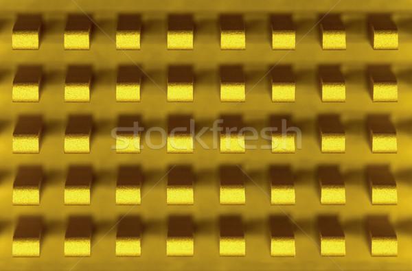 Macro-photo of golden metal radiator Stock photo © pzaxe