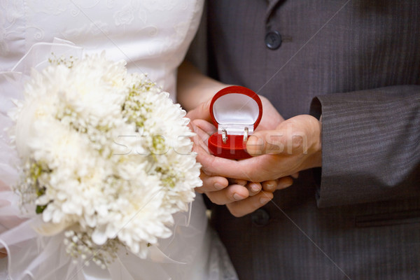 Wedding rings in hands of newlyweds Stock photo © pzaxe