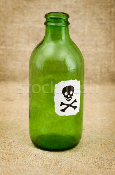 Bottle with sticker - skull and crossbones Stock photo © pzaxe