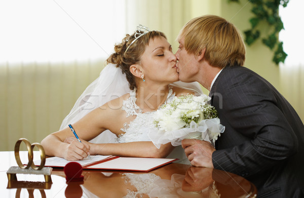 Bride and groom kiss during ceremony of marriage Stock photo © pzaxe