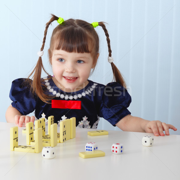 Smiling girl sitting at table Stock photo © pzaxe