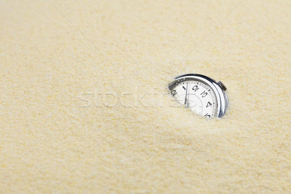 Ancient mechanical watch in sand Stock photo © pzaxe
