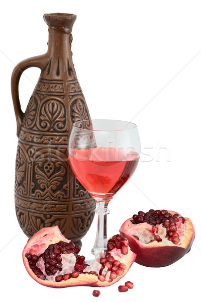 Glass of wine, bottle and a red pomegranate Stock photo © pzaxe