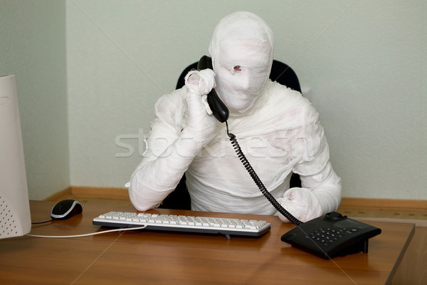Businessman mummy with telephone Stock photo © pzaxe