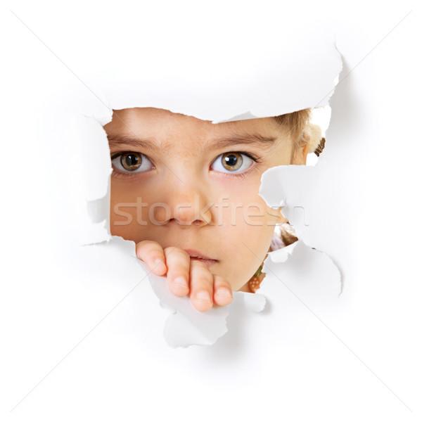Cara olhando buraco papel criança branco Foto stock © pzaxe