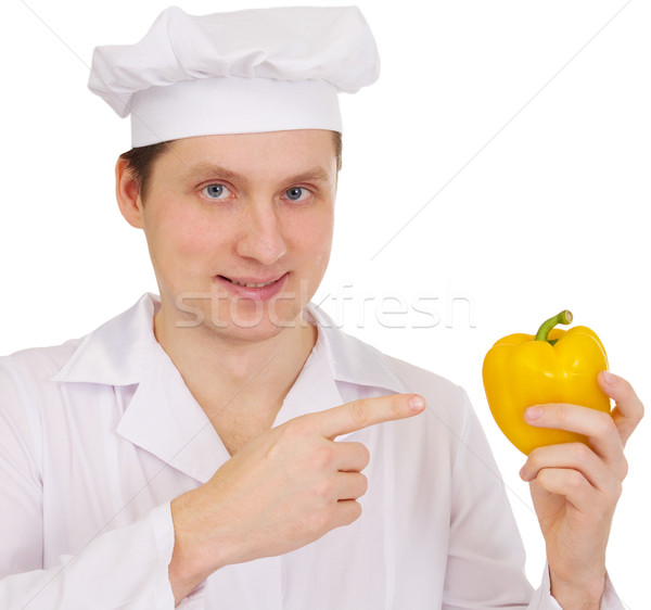 Cook with yellow paprica in hand Stock photo © pzaxe