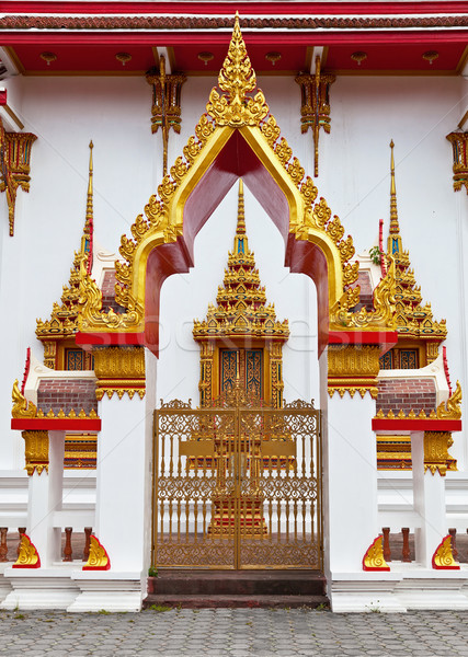 Gilded gates of an Buddhist temple Stock photo © pzaxe