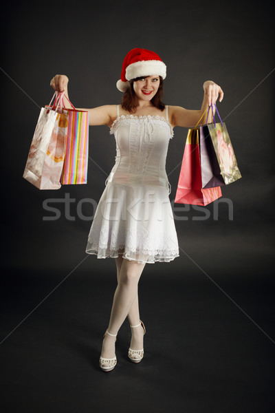 Woman rejoices to Christmas purchases Stock photo © pzaxe
