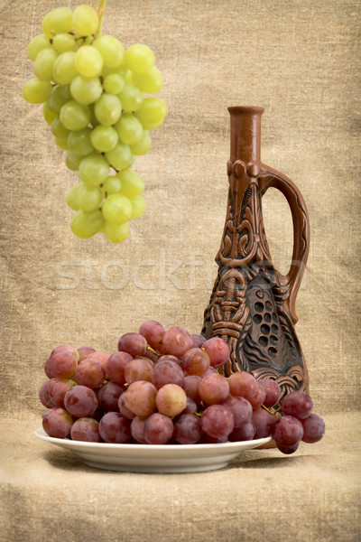 Grapes and wine in bottle Stock photo © pzaxe