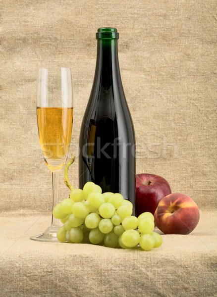Champagne bottle, goblet, grapes, apple and peach Stock photo © pzaxe