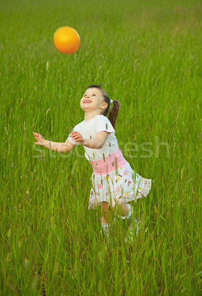 Child cheerfully plays with ball Stock photo © pzaxe