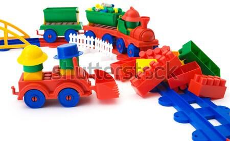 Toy bulldozer and railway on white background Stock photo © pzaxe