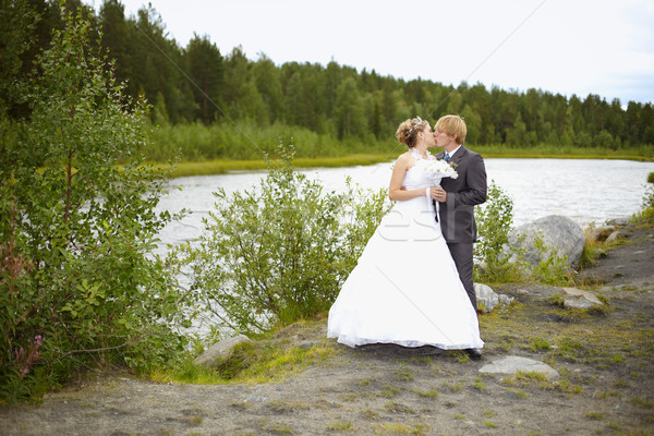 Bride and groom on nature Stock photo © pzaxe