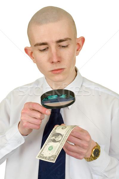 Man studying a counterfeit money Stock photo © pzaxe
