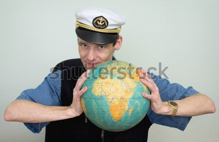 Woman in sea uniform and globe Stock photo © pzaxe