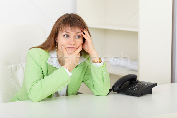 Young woman with concentration thinks on workplace Stock photo © pzaxe