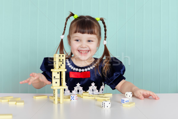 Little happy girl is playing with toys Stock photo © pzaxe