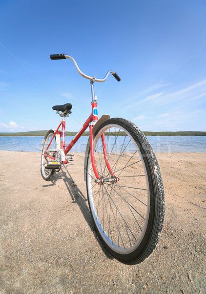 Old red bicycle photographed on beach Stock photo © pzaxe